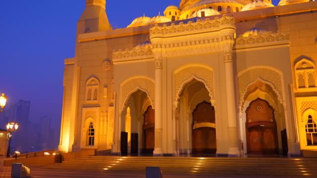 Facade-of-Al-Noor-Mosque-in-Sharjah-Emirates-Night-view-illuminated-building-