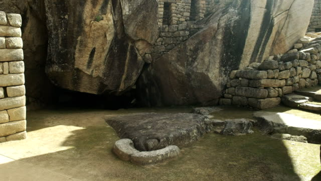 tilt-up-shot-of-the-temple-of-the-condor-at-machu-picchu