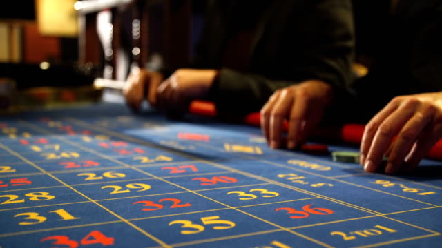 Two-men-playing-roulette-in-a-casino