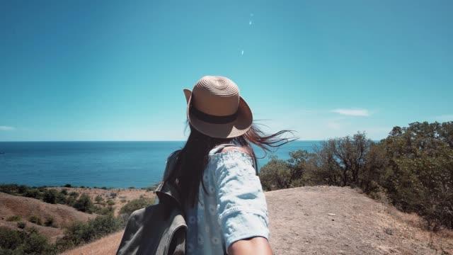 Woman-walking-holding-hand-someone-or-boyfriend-showing-amazing-seascape-POV-shot