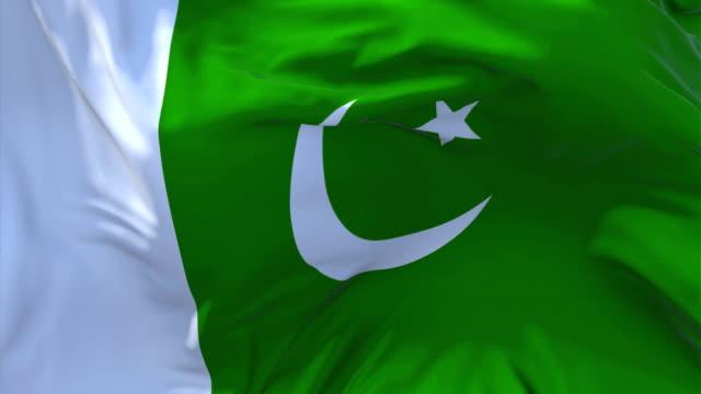 Pakistán-bandera-ondeando-en-el-viento-lenta-animación-4K-bandera-de-textura-de-tela-realista-suave-que-sopla-sobre-un-día-de-viento-continuo-fondo-de-bucle-sin-fisuras-
