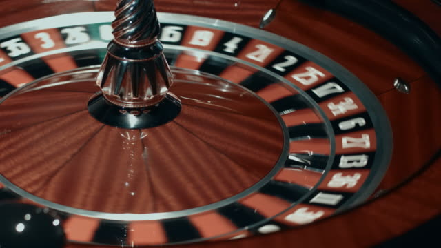 Spinning-roulette-wheel-with-stopped-ball-Close-up-classic-casino-roulette