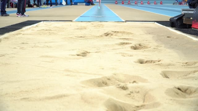 Athlete-practicing-high-jump-at-sports-venue-4k