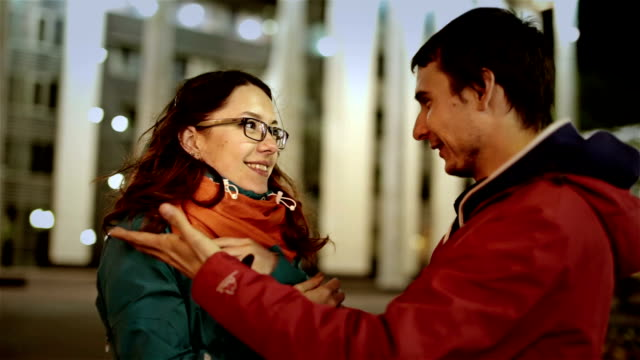 Attractive-young-girl-wait-for-her-boyfriend-love-They-happy-meet-and-embrace