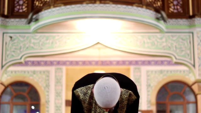 young-man-worship-in-a-mosque-