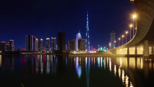 noche-iluminación-dubai-más-alto-edificio-Bahía-panorama-mundial-4-tiempo-k-lapso-Emiratos-Árabes-Unidos