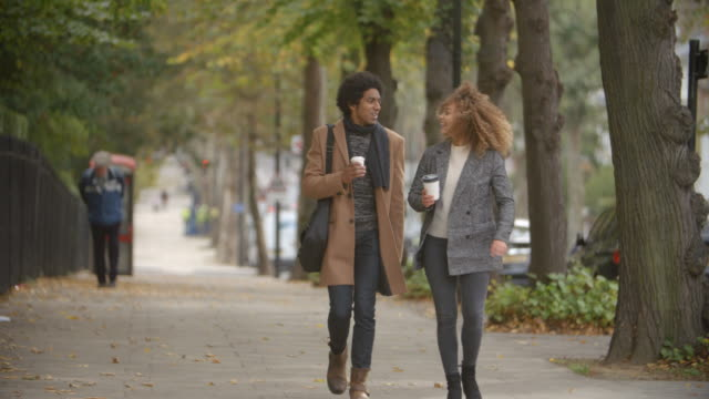 Stylish-Couple-Walk-On-Fall-Street-In-City-In-Slow-Motion