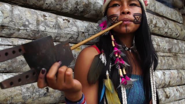 Indigenous-Woman-Smoking-Pipes-in-a-Tupi-Guarani-Tribe-Brazil
