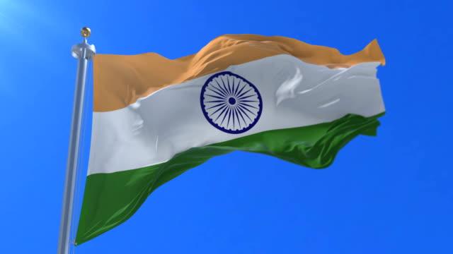 Flag-of-India-waving-at-wind-in-slow-in-blue-sky-loop