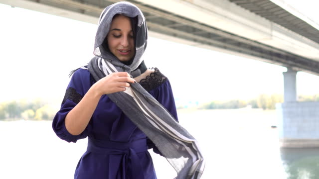 Middle-eastern-girl-putting-on-own-hijab