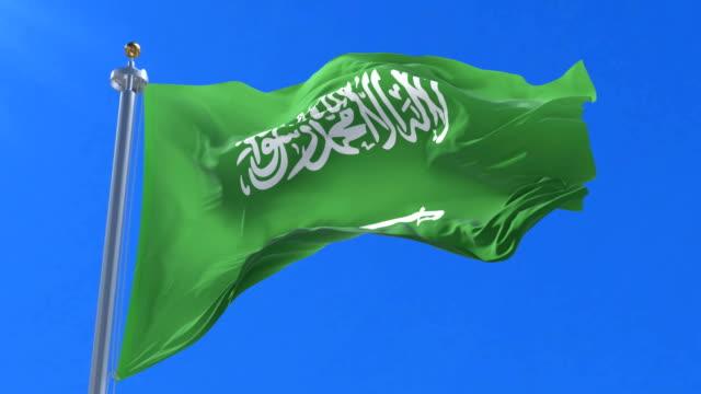 Flag-of-Saudi-Arabia-waving-at-wind-in-slow-with-blue-sky-loop
