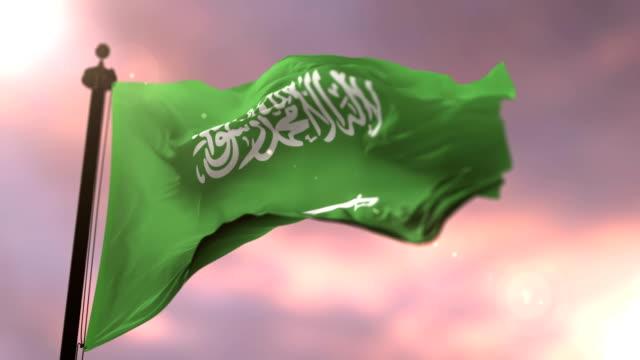 Flag-of-Saudi-Arabia-waving-at-wind-in-slow-at-sunset-loop