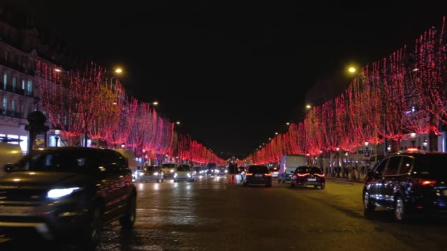 Zoom-in-at-night-to-Avenue-des-Champs-Élysées-illuminated-by-lights-of-Christmas
