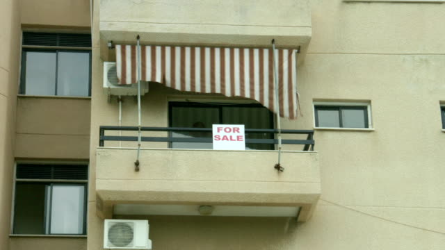 For-sale-sign-on-apartment-balcony-Real-estate-agency-services-