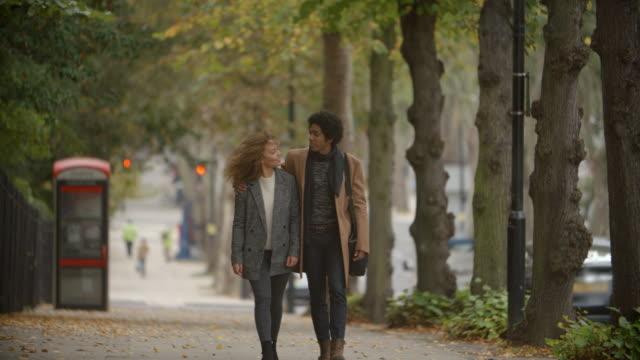 Romantic-Couple-Walk-On-Fall-Street-In-City-In-Slow-Motion