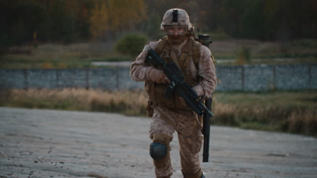 Portrait-of-Fully-Equipped-and-Armed-Soldier-Running-Outdoors-Slow-Motion-