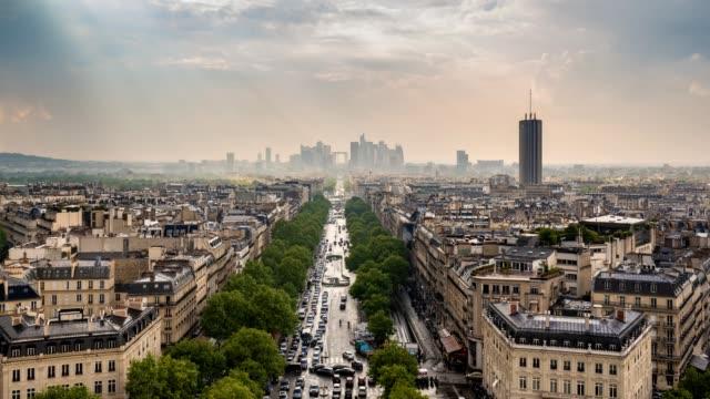 Paris-city-skyline-timelapse-at-La-Defrense-and-Champs-Elysees-view-from-Arc-de-Triomphe-Paris-France-4K-Time-lapse