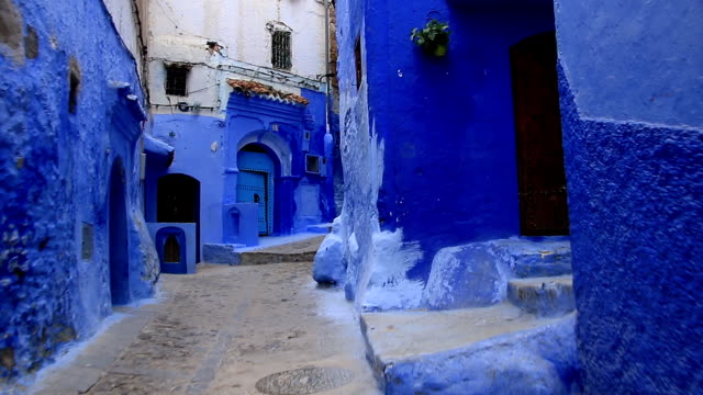 POV-walking-in-blue-town-Chefchaouen-Chaouen-/-Morocco-first-point-of-view