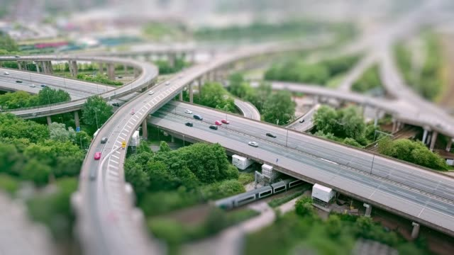 Aerial-view-of-a-complex-motorway-road-junction-with-traffic-moving-and-tilt-shift-effect