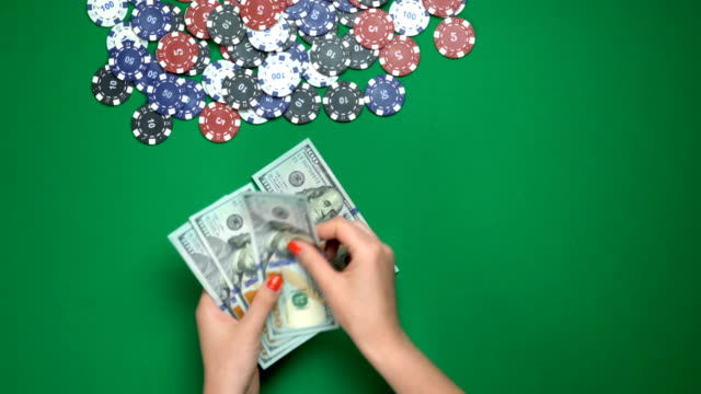 Poker-player-counting-money-on-casino-table-victory-successful-game-top-view