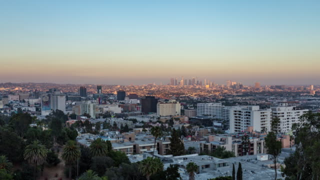 Full-Moon-Rising-Over-Downtown-Los-Angeles-Day-to-Night-Sunset-Timelapse-Wide