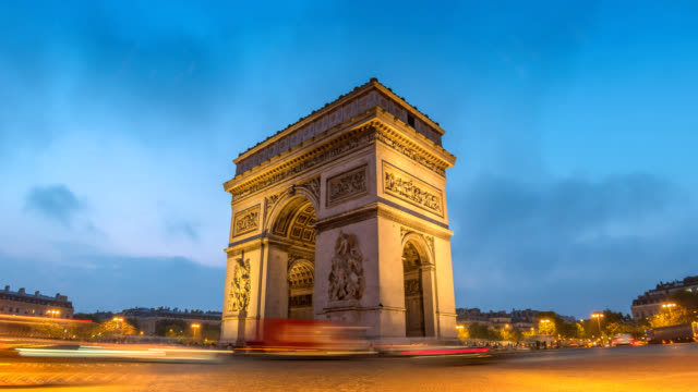Paris-France-time-lapse-4K-city-skyline-night-to-day-timelapse-at-Arc-de-Triomphe-and-Champs-Elysees