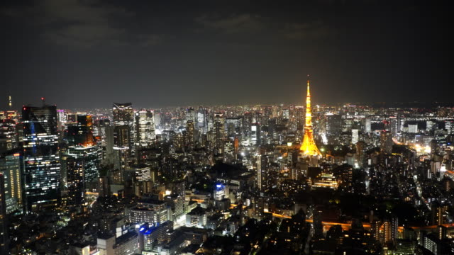 wide-angle-pan-of-tokyo-tower-at-night-from-mori-tower-in-tokyo