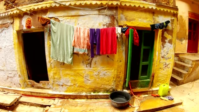 Slums-of-Benares-things-dry-over-tacky-enterance-to-house