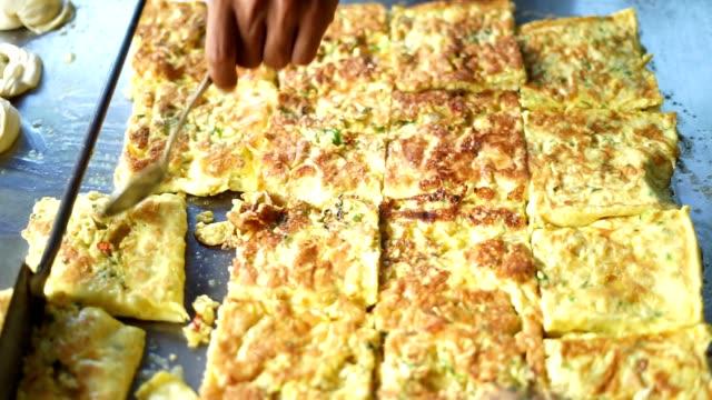 Food-Vendor-frying-Martabak-Aceh-at-street-market
