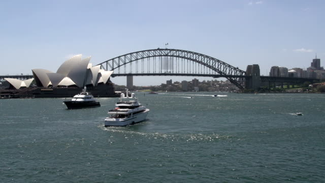 Big-private-cruise-ship-in-Sydney-with-Opera-house-and-Harbour-bridge-at-the-background