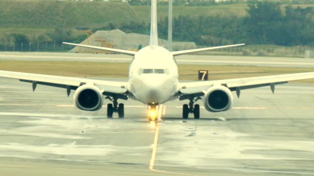 Zooming-into-the-cockpit-as-the-aircraft-taxis-towards-the-terminal-
