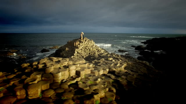 """4k-Aerial-Shot-of-a-Queen-on-Giant-s-Causeway-and-3D-Animated-text-""""Nature"""""""
