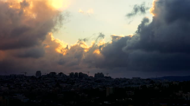 Sunset-with-huge-cumuli-clouds-over-the-city