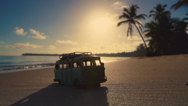 Beautiful-tropical-island-beach-sunrise-and-car-miniature-Punta-Cana