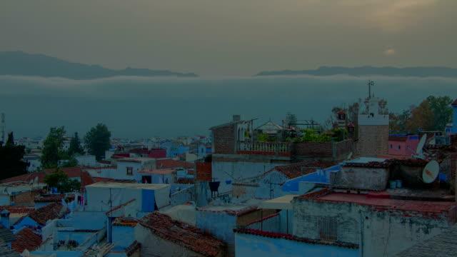 Schöner-Sonnenuntergang-Zeitraffer-über-afrikanische-blaue-Stadt-Chefchaouen-in-Marokko-Chaouen