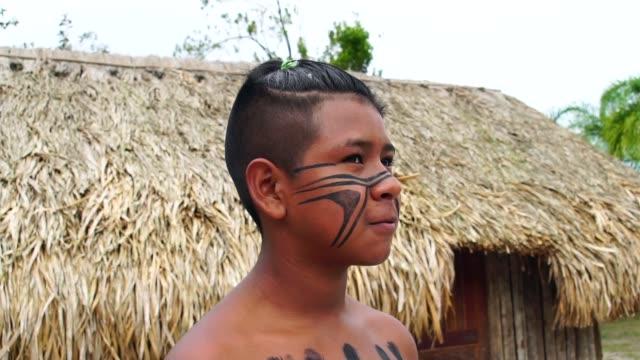 Native-Brazilian-Boy-on-a-indigenous-Tupi-Guarani-Tribe-in-Brazil
