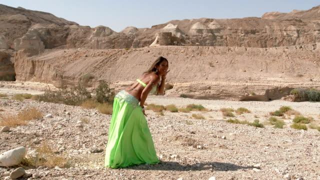 Beautiful-female-dancer-Belly-dance-Desert-Sexy-green-dress-dancing-Full-shot