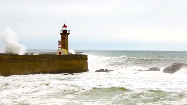 Strong-waves-break-about-the-pier-the-lighthouse-on-the-shore-of-the-Atlantic-Ocean