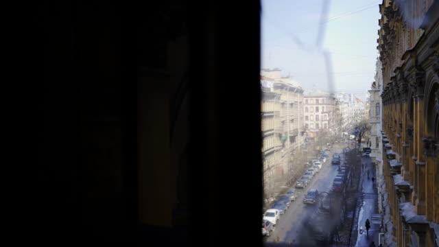 Cityscape-through-breaking-glass