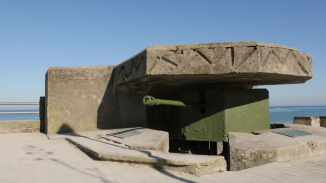 Old-WW2-German-canon-hidden-in-bunker-on-beaches-in-northern-France-Normandy