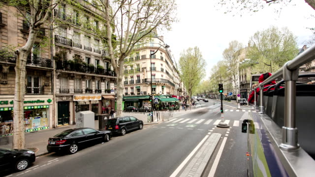 View-from-moving-touristic-bus-on-road-and-buildings-is-Paris-France-timelapse-part1