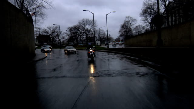 Motorcycle-Going-Through-Tunnel-in-Rain