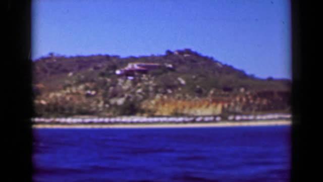 1952:-Boat-tour-fancy-wealthy-tropical-cliff-ocean-view-villas-mansions-homes-