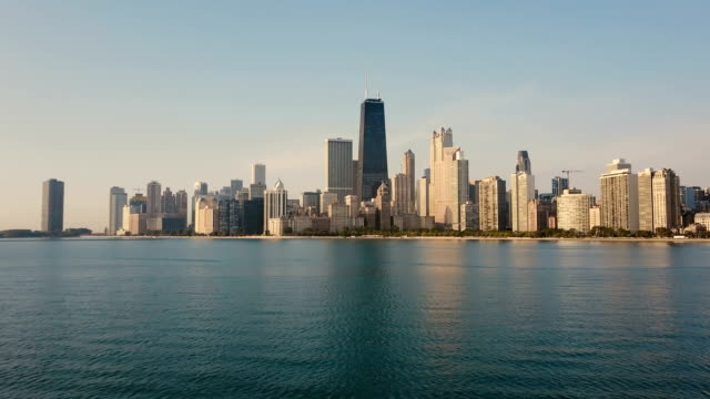 Aerial-view-of-the-Michigan-lake-and-Chicago-America-Drone-flying-low-over-the-water-to-the-downtown-in-the-morning