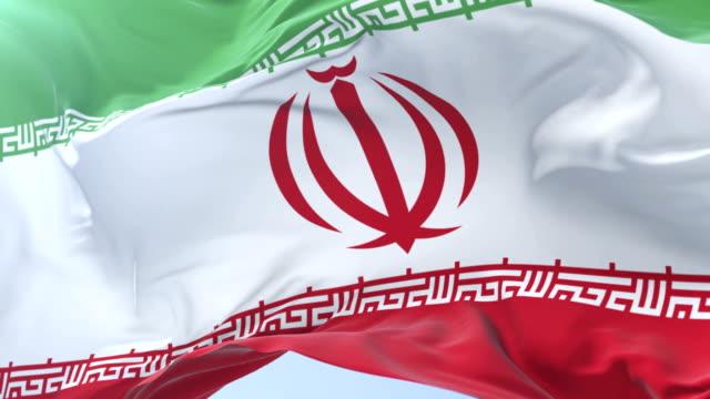 Irani-flag-waving-at-wind-in-slow-in-blue-sky-loop