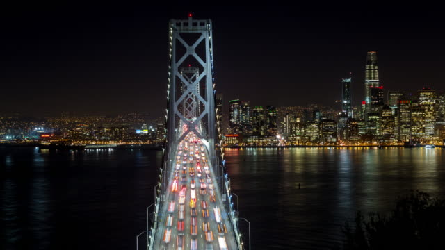 San-Francisco-Oakland-Bay-Bridge-and-Downtown-at-Night-Timelapse