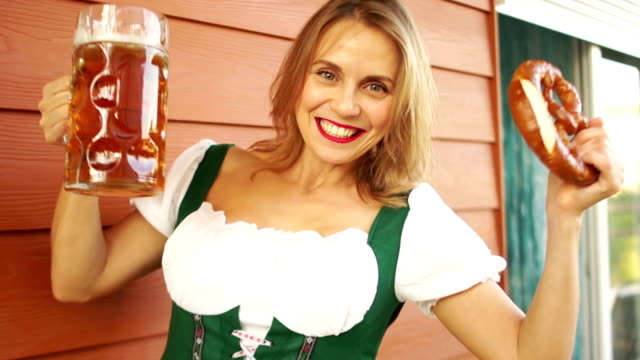 Girl-with-beer-and-pretzel-barman-at-oktoberfest-Sexy-white-toothed-smile-red-lips-sincere-joy-National-Bavarian-Costume