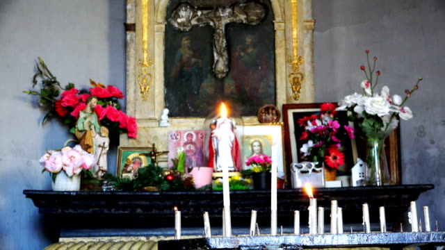 burning-candle-near-icons-in-the-Church