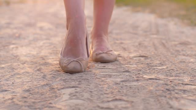 Woman-feet-in-summer-shoes-in-dust