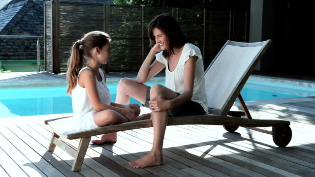 Mother-and-daughter-by-pool